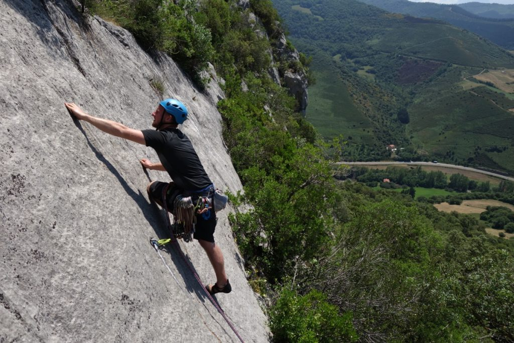 Josh Douglas on a easy F5 slab in sector Amazonia, Pendes. Near Hermida Gorge, Picos Du Europa.