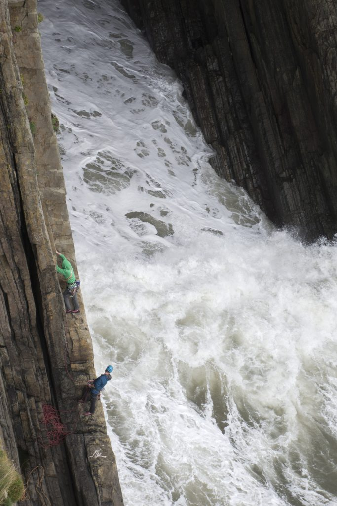 Jesse King climbing Shangri-La, a classic Severe at Baggy Point in North Devon. A route we managed to sneak in between a storm and the rising tide.