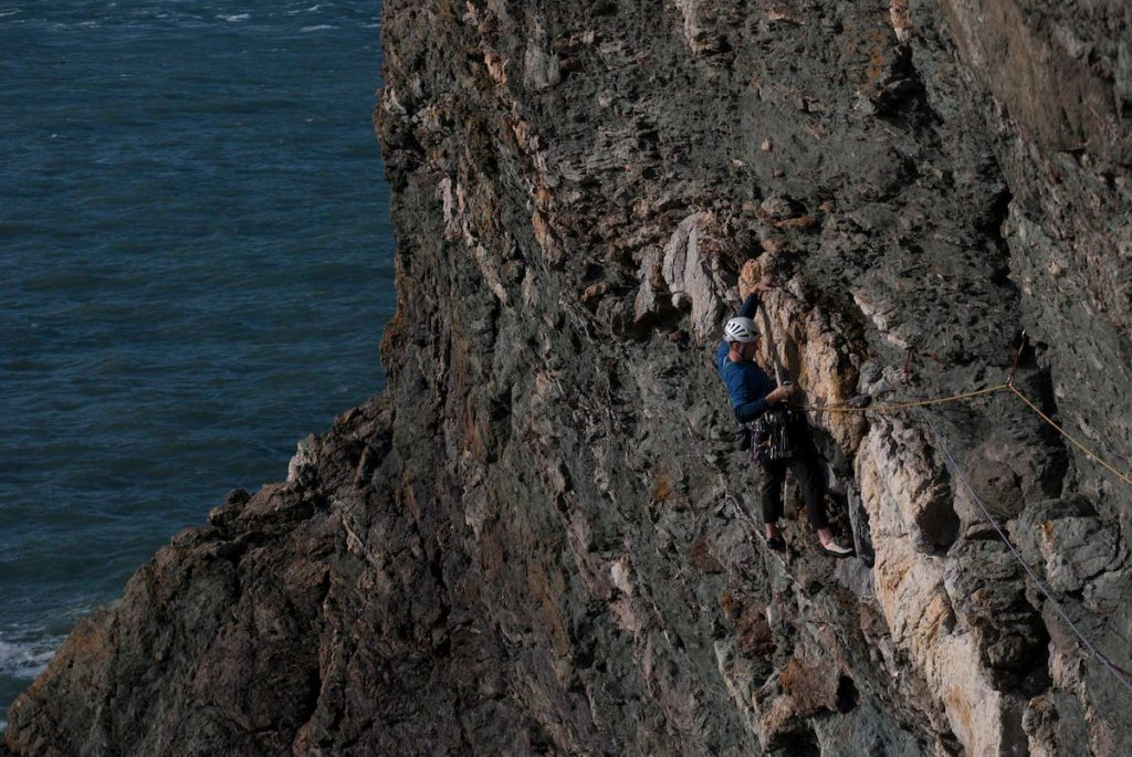 Martin Chester climbing the classic Bardsey Ripple, E2 on the Llyn Peninsular.