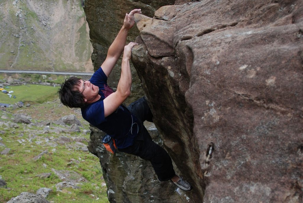 Mark reeves shark wrestling on The Boyson's Groove, V4, Llanberis Pass.