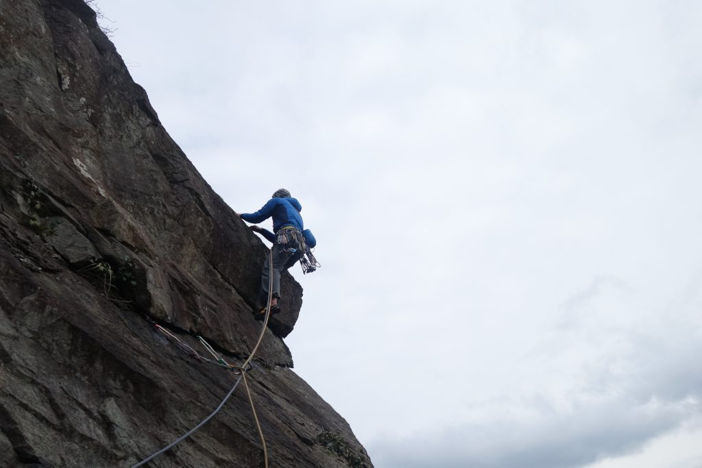 Simon Lake climbing the Merlin Super Indirect Variation at Tremadog. A fine and exposed HVS/E1.