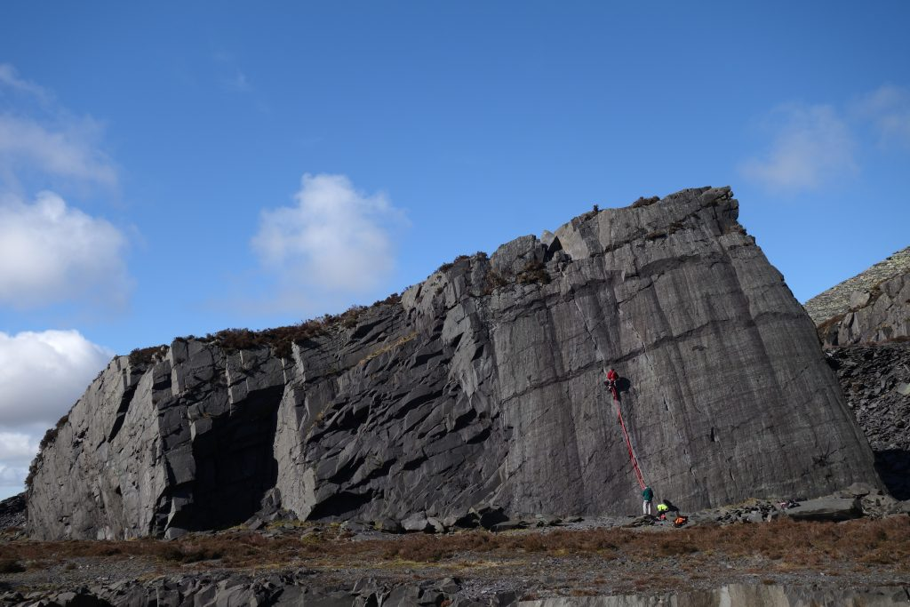 The iconic Seamstress Slab in the Dinorwic quarries, with a climber on Seamstress.
