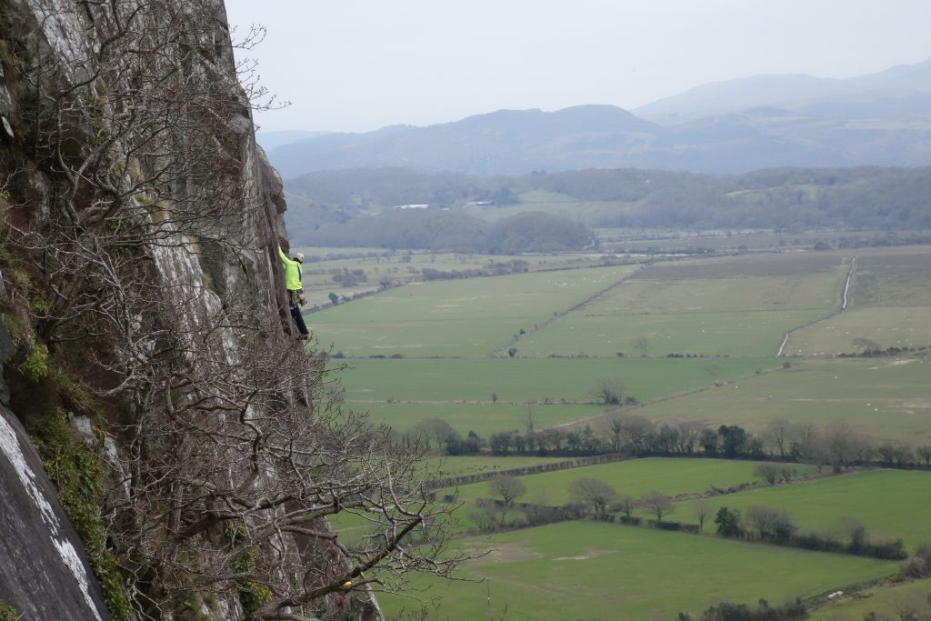 A climber on the overlooked classic of Strangeways, HVS Tremadog.