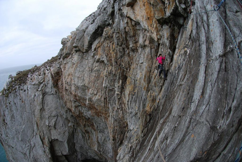 Cheymoon crusing across the final pitch of A Dream of White Horses, Wen Zawn, Gogarth, one of the most famous HVS climbs in the world.