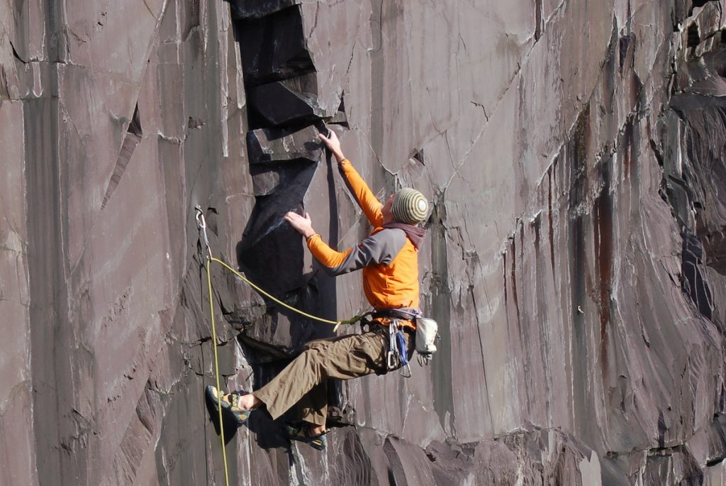 Jack Geldard wrestles with the incredible Drowning Man on the Rainbow Wall area of the Dinorwic slate quarries.