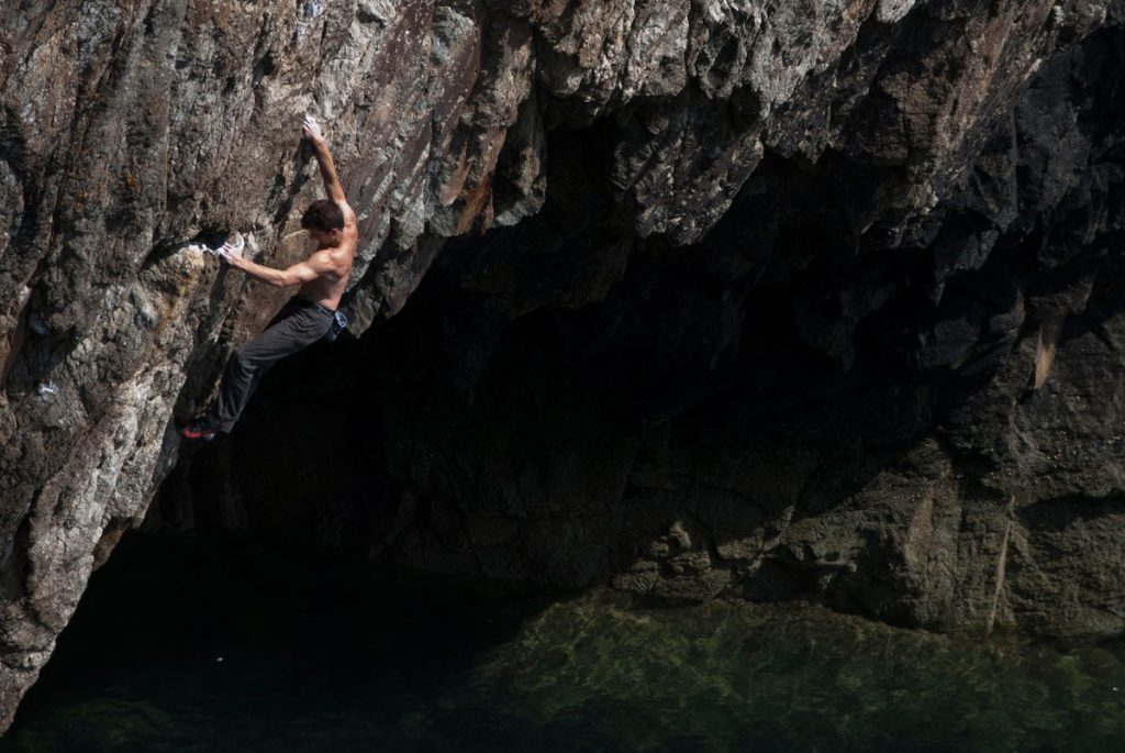 Sam Underhill looking toned and in control on the classic Deep Water Solo, Electric Bliue, E4 5c, Rhoscolyn, Gogarth.