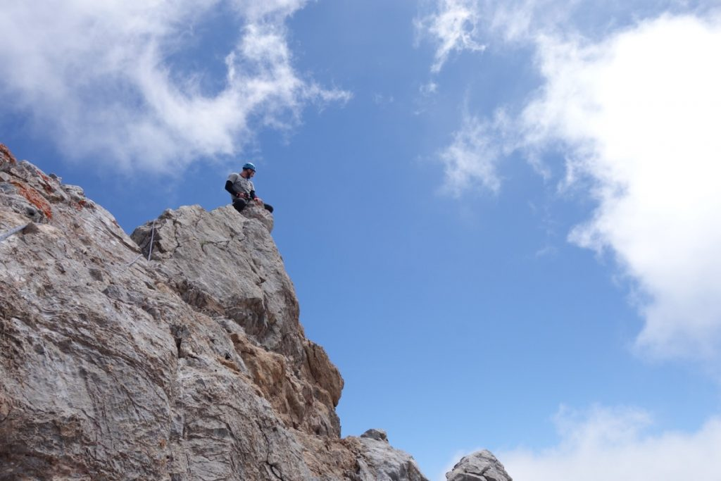 Josh Douglas on Top on a 100m high limestone tower near fuente du, in the Picos Du Europa
