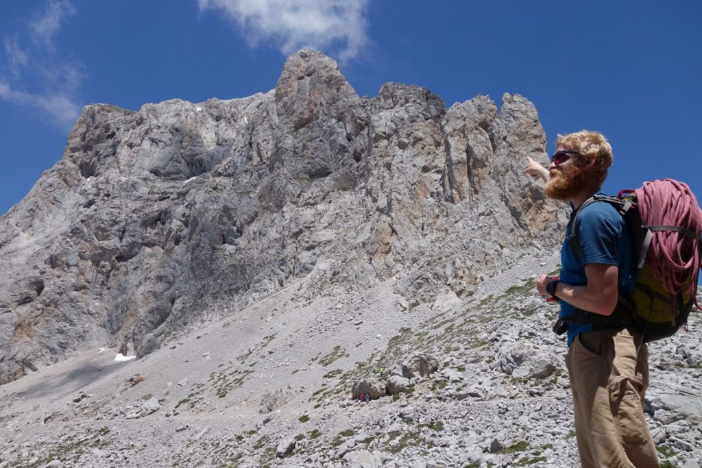 Jesse King looking up at the tower near Fuente Du in the high Picos Du Europa.