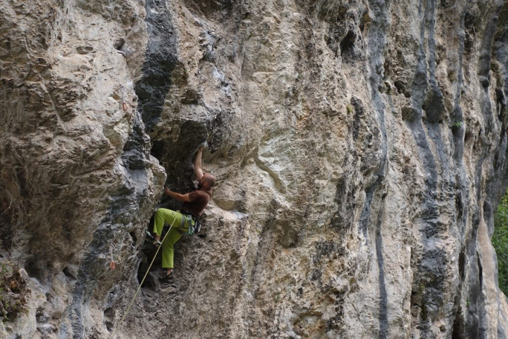 A local climber powering his way up the classic 7a in the Hermoida Cave.