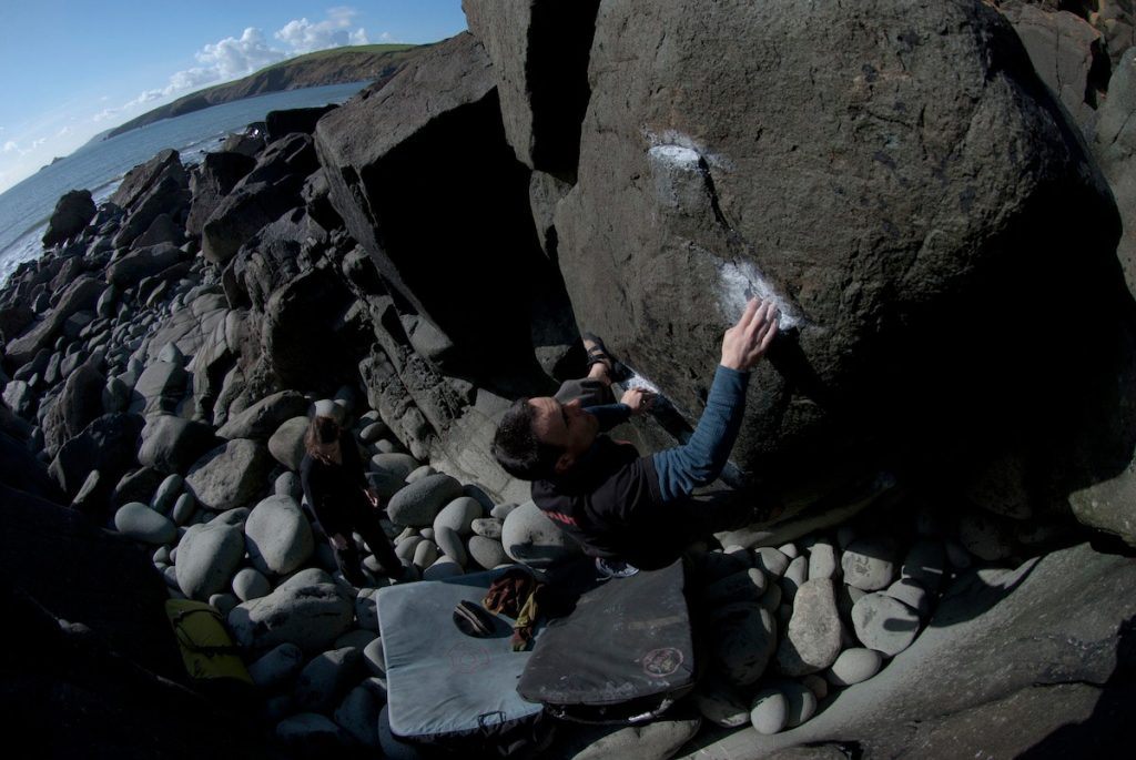 Llion Morris climbing the classic V4 Jaw Breaker, a fantastic problem at Porth Ysgo.