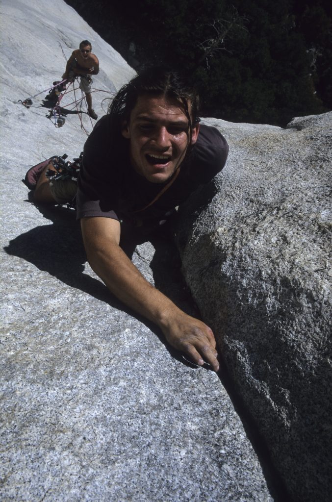 Snowdonia Mountain Guides owner Mark Reeves on the First Free Ascent of Pitch 3 of Passage to Freedom, one of Leo Houlding's first attempts at free climbing El Cap (cicra 2000). The party atmosphere capture by his miniDisc player an speaker blaring techno all over the cliff as we climbed, how times have changed!