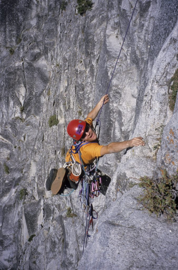 Snowdonia Mountain Guides owner Mark Reeves making a pendulum on the Classic NW Face of Half Dome, Yosemite, back in 2001.
