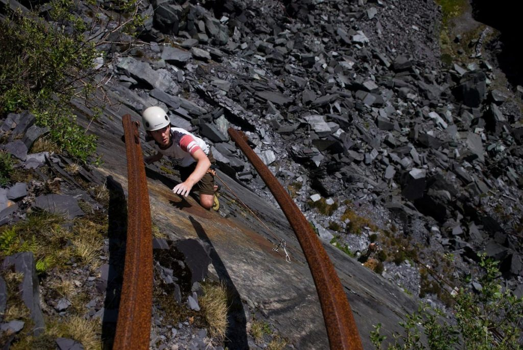 James Oswald reaching uop for the rails on the final move of Off the Beaten Track. E3 5c. Australia, Dinorwic Quarries.