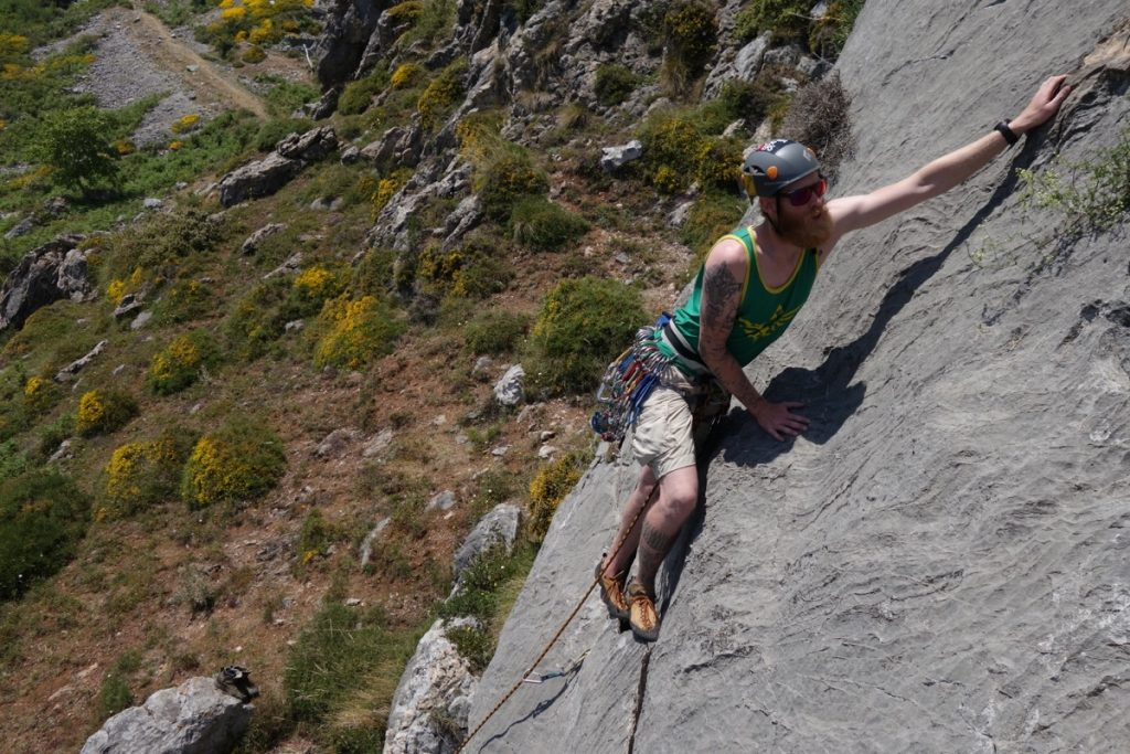 Jesse King trad climbing an easy route in Picos Du Europa