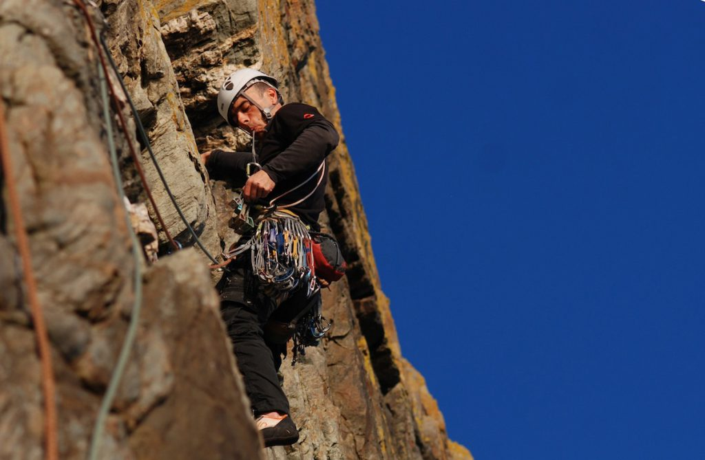 Llion Morris climbing the classic Rap, VS, on Castell Helen, sister route to Pel, both of which rouchly follw the abseil line.
