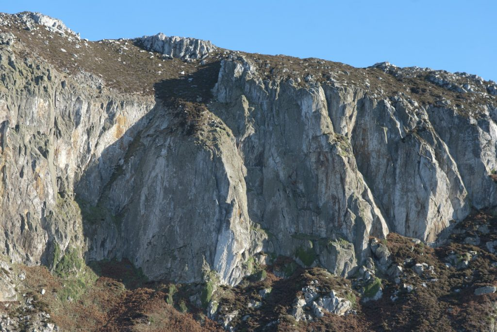 The Upper Tier of Gogarth, with the stand out crackline of The Strand, E2 clearly seen 'standing out' from the rest of the lichen covered rock on the left of the shot.