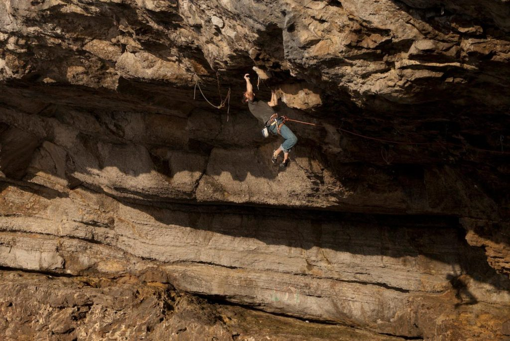 Dave Rudkin campusing the last move of Stiff Upper Lip, 8a Pigeons Cave, Great Ormes.