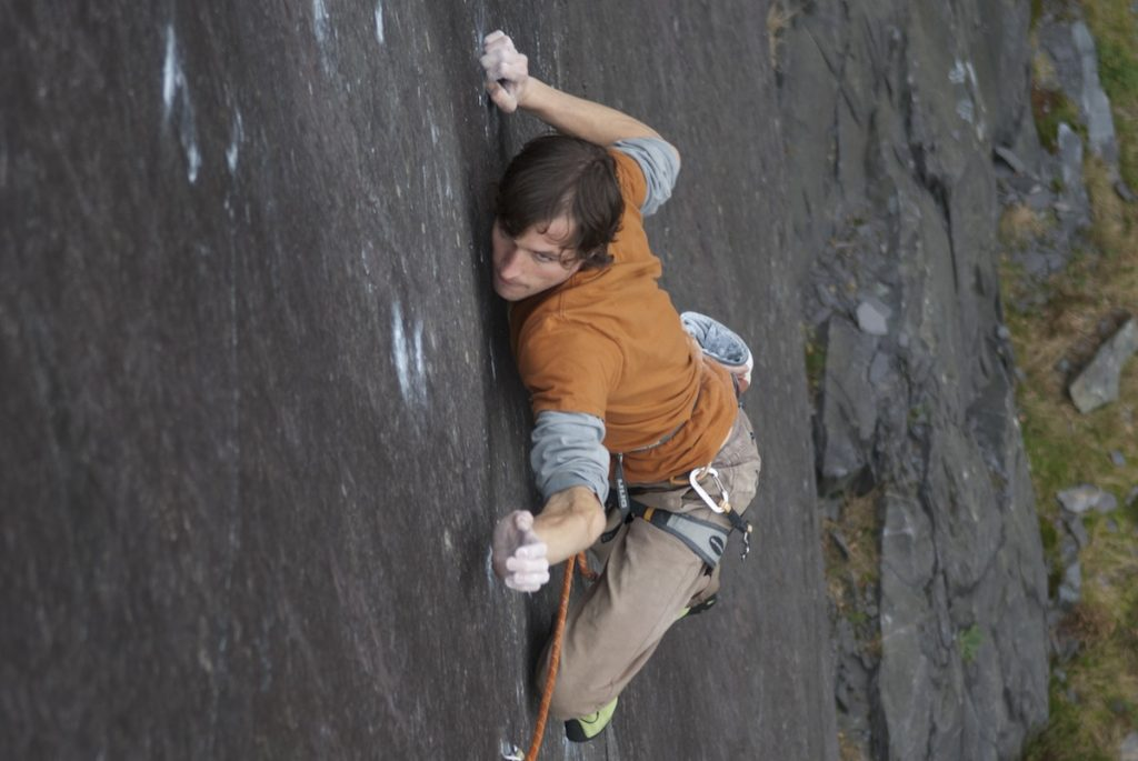 Pete Robins focusing hard as he attempts the Very Big and the Very Small, a 8b+ slab on Rainbow Slab!