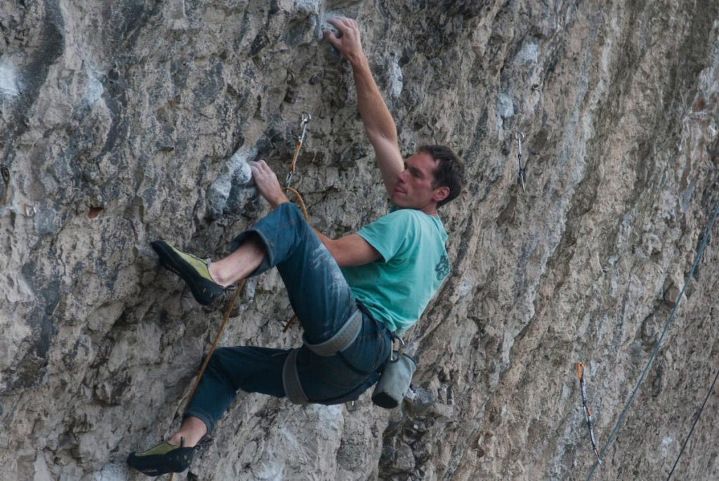 Tim Neill working his way up the Boat People a classic 7c on the Diamond.