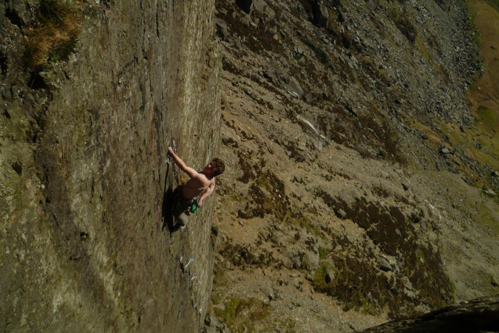 Ollie Cain looking in control as he nears the final crux wall of the power sapping Foil, E3, Dinas Cromlech.