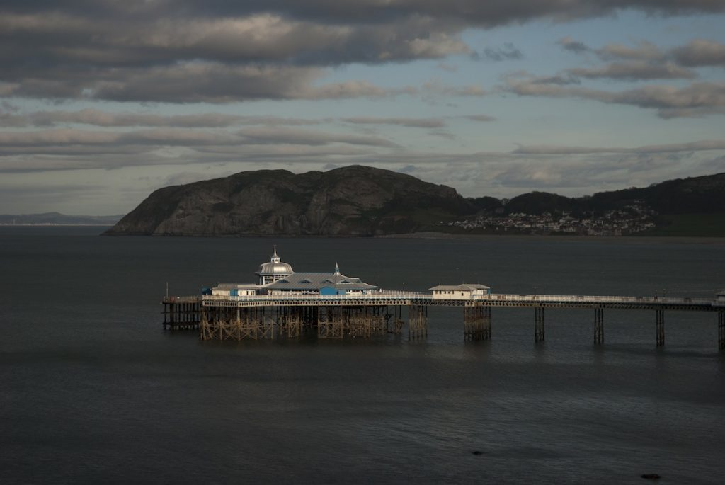 The View of Llandudno Pier, North Wales from the Great Ormes with the Little Ormes and the Diamond in the Background.