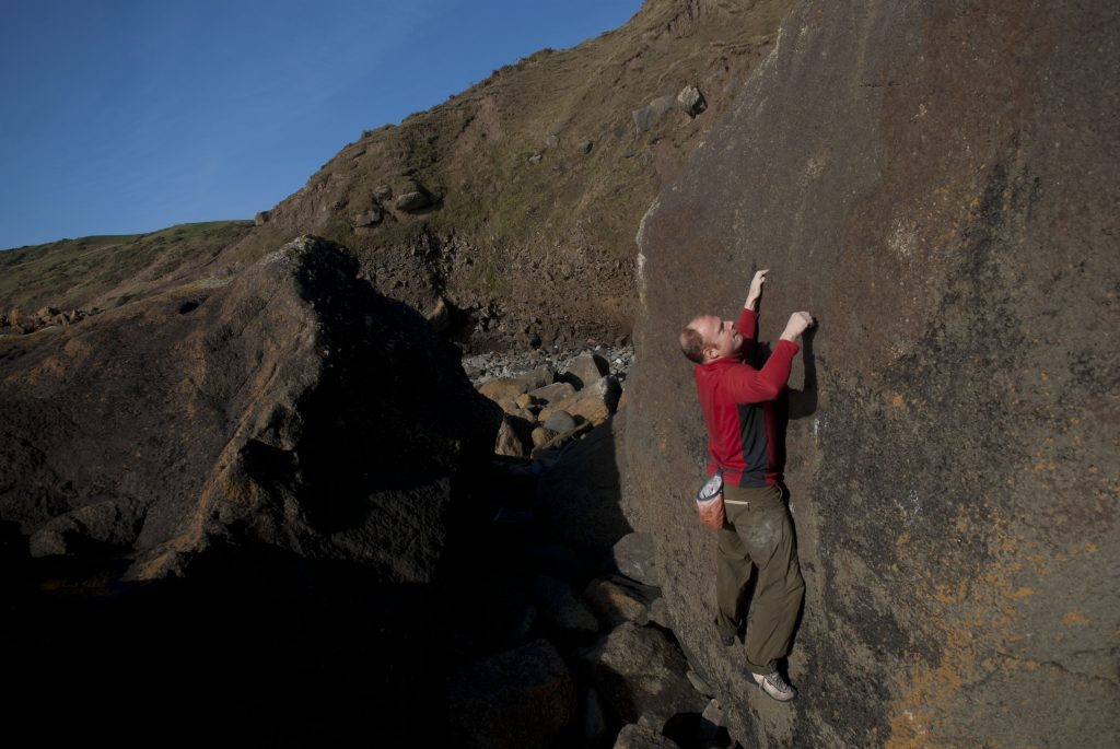 Dave Evans climbing on perfect gabbro at the amazing Porth Ysgo