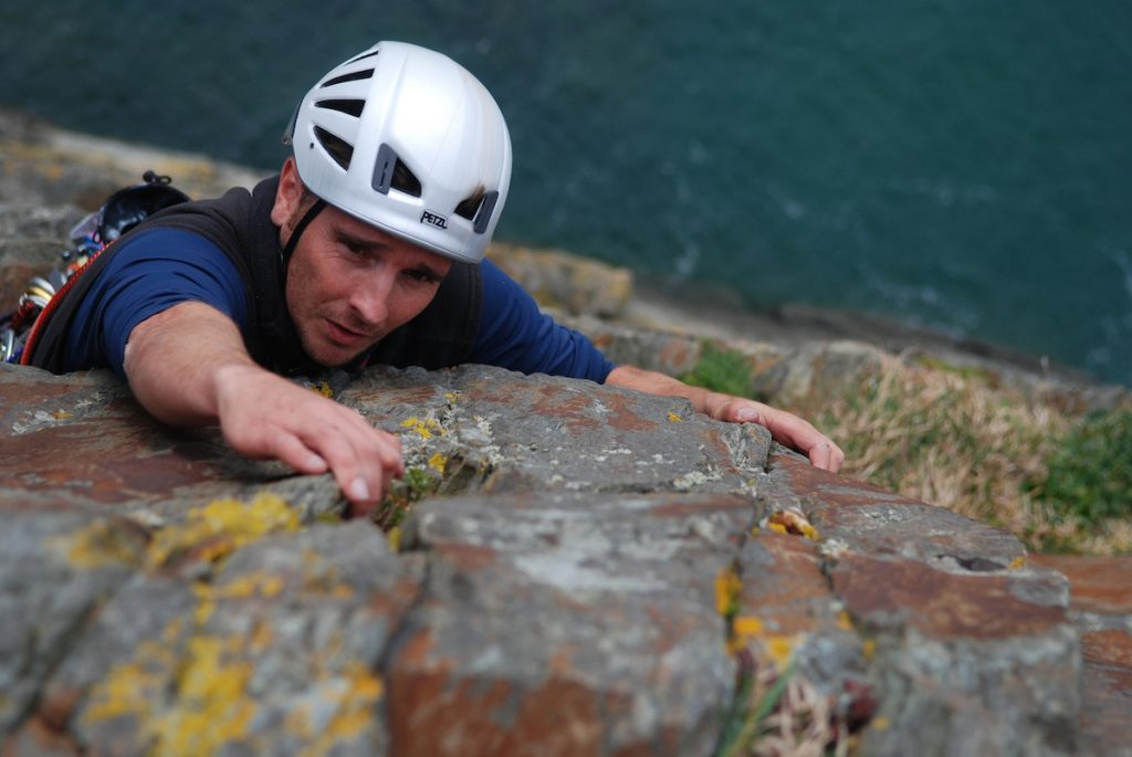 A climber tackles the top pitch of Rap at Castell Helen, opne of the classic VS's at Gogarth.
