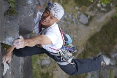 A japanese climber on a BMC International Meet appreciating the mix route of Colossus, Rainbow Slab area, Slate quarries
