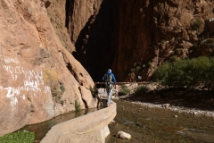 Balancing along the irrigation canal, walking back from a crag into the main Todra Gorge.