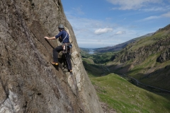 An early start lets you catch the morning sun on the Eastern Flanks of the Nose of Dinas Mot with the spectacular view down the valley only adding to the atmosphere of great climbing. Here Adam Riches enjoys the first pitches of Direct Route (VS) on Dinas Mot.