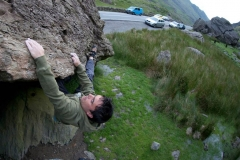 Llion Morris on the Heel Hook Traverse a classic boulder problem on the Cromlech Boulders.