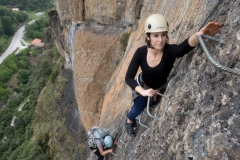 A climber enjoying her day off on one of the two great Via Ferrata in the Potes area of the Picos Du Europa.