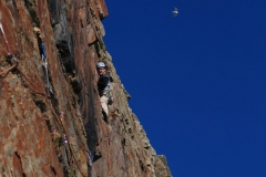 Mark Reeves stepping up into the fine groove of North West Passage a classic E1 on Castell Helen, South Stack, Gogarth