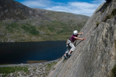 A client working on her lead climbing on the Pulpit Route, Diff, on the Milestone Buttress, Ogwen Valley.