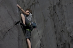 A climber on the desperate Cig-Arete, 7b on the Rainbow Walls
