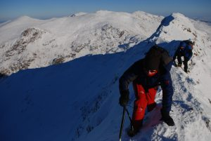 Traversing Crib Coch in full winter conditions on a rare still and sunny day.