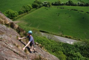 Climbing the classic Boo Boo at Tremadog on one of our rock climbing courses