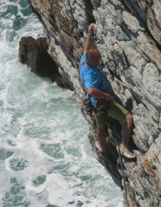 Martin Chester climbing the classic Fanfare at Rhoscolyn the HVS that is like a jug indoor route it is so steep for the grade.