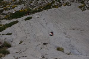 Kate Brookes Carothers climbing the bold first pitches on the Resullion Slab below Cerro Agero, Picos Du Europa.
