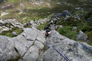 Guiding a client up Grooved Arete