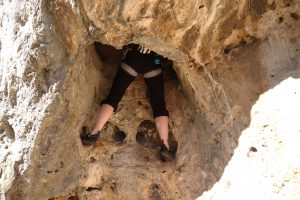 Lynne Savage climbing the classic VS route that climbs up and through one of the water-worn holes in sector hydraulics in Gandia.