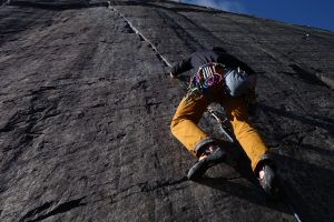 A climber starts up the classic E1, Seams the Same in the Dinorwic Slate Quarries.