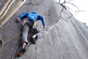Simon Lake foot traversing the crack of the Monster Kitten, a great E1 in Vivian Quarry.