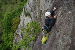 A climber being coached on Merlin Direct, Tremadog