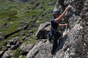A real and composed Adam Riches at the end of the crux traverse on pitch two of Kirkus Direct on Clogwyn Yr Oen