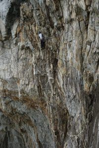 Adam Riches on the imposing final pitch of Dream of White Horses, with its wild exposure it really is one of the best pitches of HVS climbing anywhere.