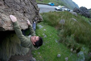 Llion Morris on the Heel Hook Traverse a classic boulder problem on the Cromlech Boulders