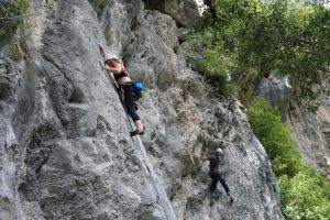 Kate Brooks Carothers climbing a 6b in the Hermoda Cave area.
