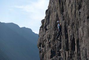 Llion Morris eyeing up the traverse on Karwendal Wall, Clogwyn Y Grouchan.