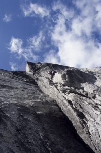 Steve Sinfield climbing the initial damp grooves pitches on the amazing 17 pitch remote wall the Lotus Flower Tower in the Cirque of the Unclimbables. In order to fix a rope to allow a speedy blast off.